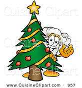 Cuisine Clipart of a Festive Chefs Hat Mascot Cartoon Character Waving and Standing by a Decorated Christmas Tree by Toons4Biz